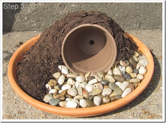 Awesome idea for a fairy garden: a Hobbit Hole! Add moss on top and a little door for the perfect effect.