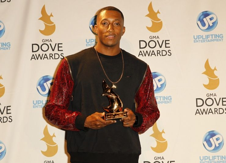 Lecrae shows off his award for Rap/Hip Hop Album of the Year at the 44th Annual GMA Dove Awards on Oct. 15 in Nashville, Tenn.