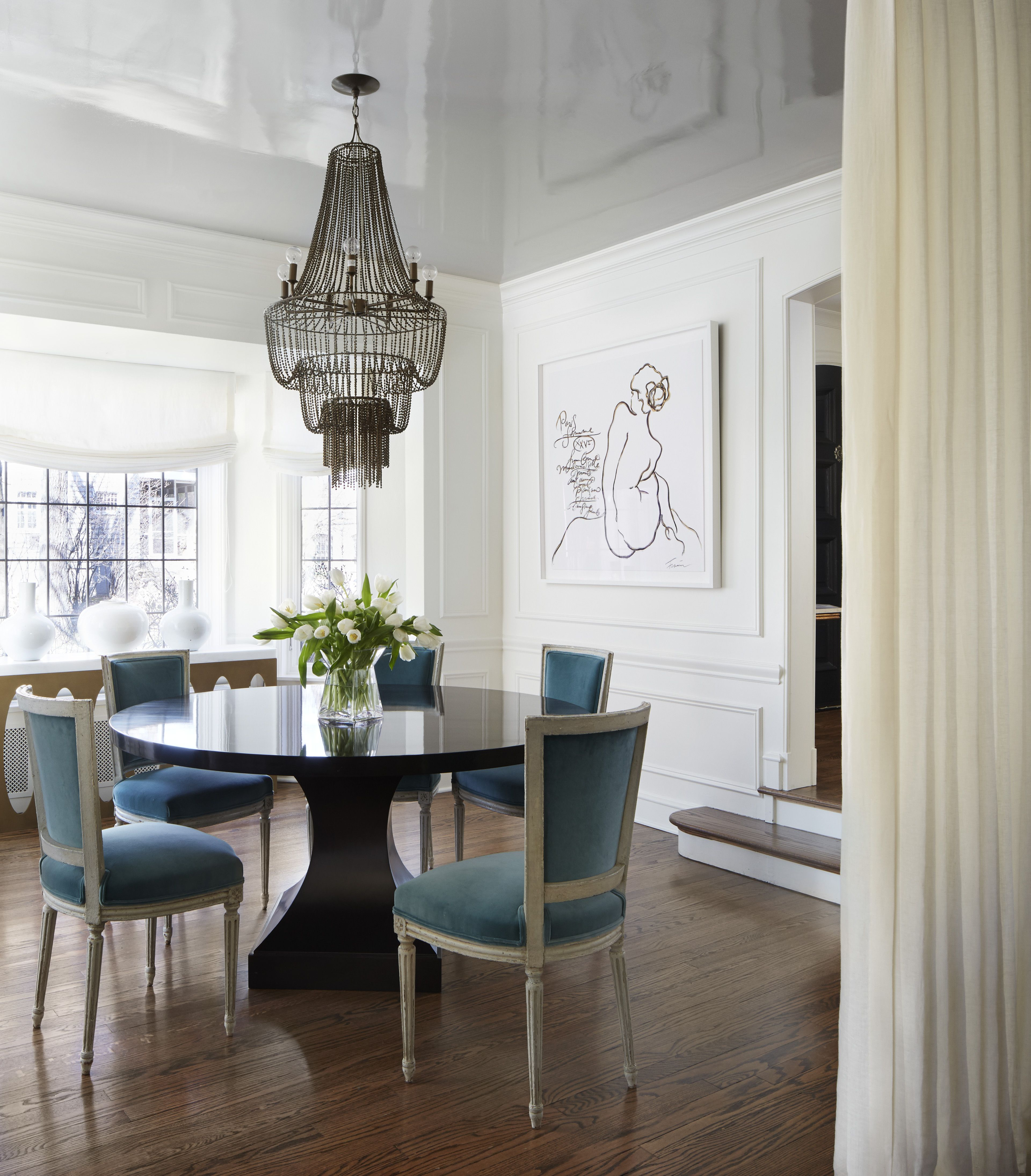 Dining Room With Lacquer Ceiling Chandelier And Custom Art