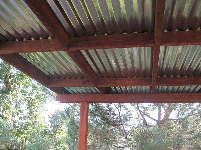 Dakota Installed A Corrugated Metal Roof Over About 2 3 Of The Deck To Provide Shade And Shelter From Rain Descripti Patio Roof Pergola Backyard Patio Designs