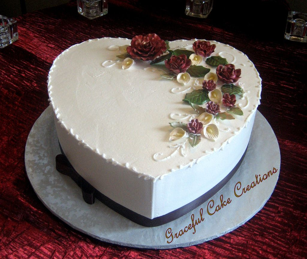 Elegant Heart Shaped Wedding Cake with Burgundy Roses and White Calla Lilies in 2020   Heart ...
