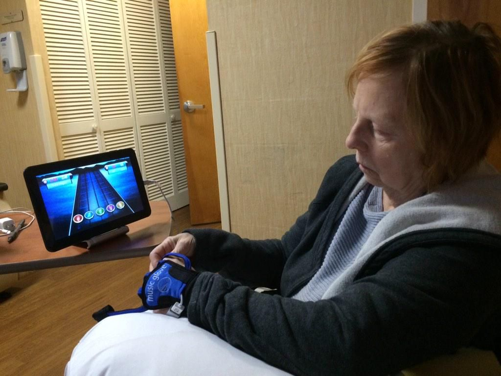 """Thanks @MusicGlove really cool device for stroke patients-  mom's hand and fingers are trying to """"fire""""!"""