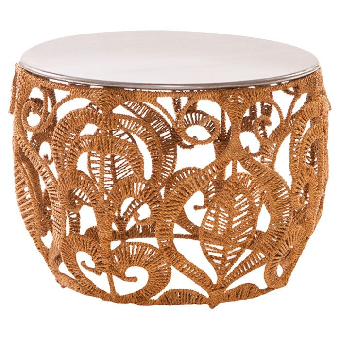 Accent table featuring a wrought iron frame and intricate ...