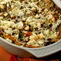 This is a fabulous lasagna made with an artichoke and spinach mixture which has been cooked with vegetable broth, onions and garlic.  The mixture is layered with lasagna noodles, pasta sauce, mozzarella cheese, and topped with crumbled feta.