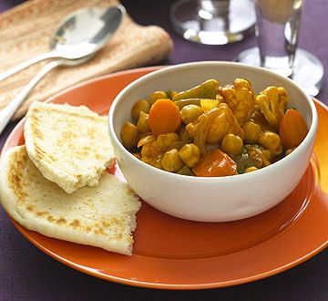An onion and hot curry powder mixture spices up cauliflower, green pepper, carrots, and chickpeas.