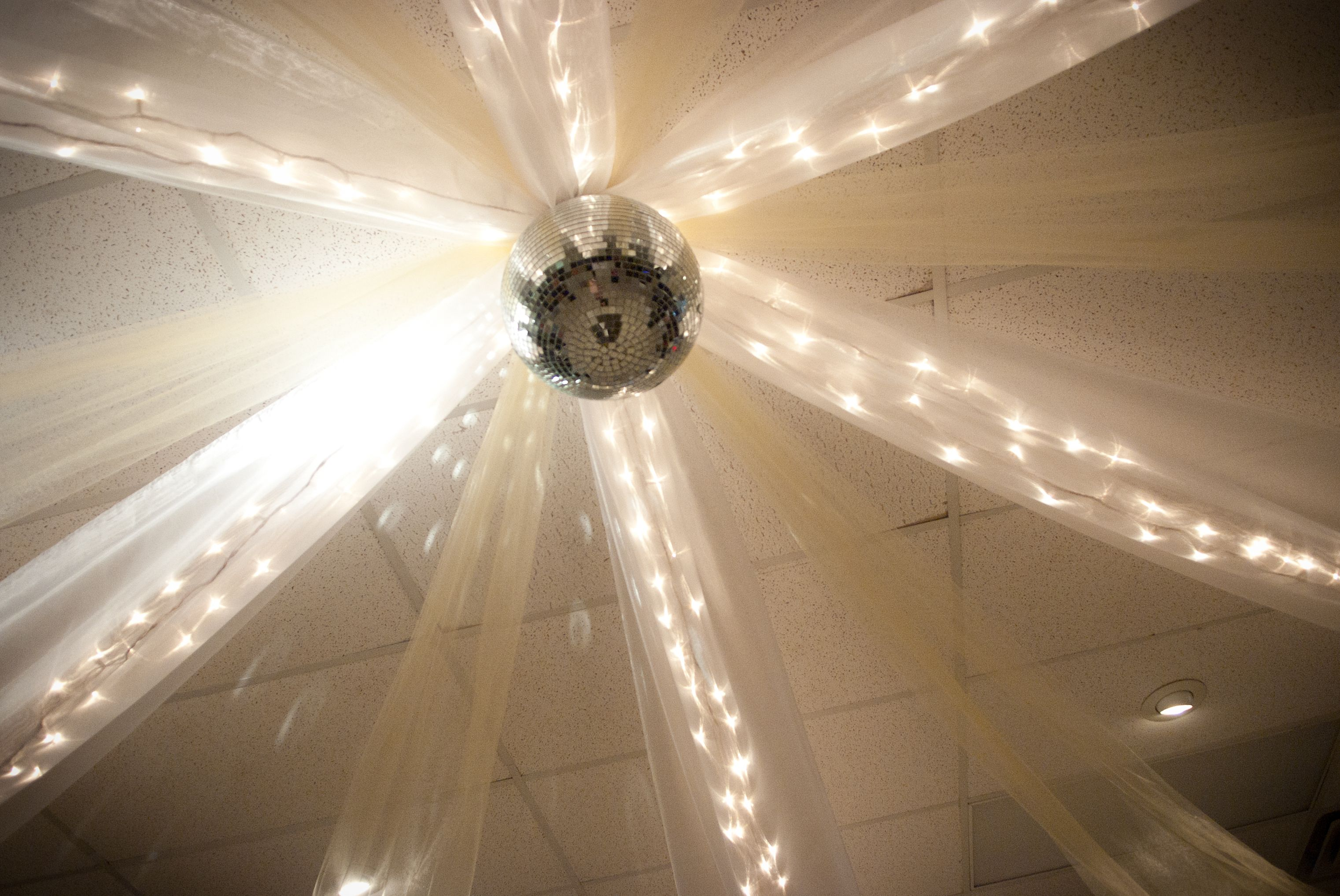 Wedding decorations tulle and lights  Wedding Reception ceiling decor with yellow and white tulle