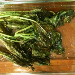 Crunchy Cajun roasted hearts of kale & collard. Couldn't keep my 7 year old away from 'em!!!