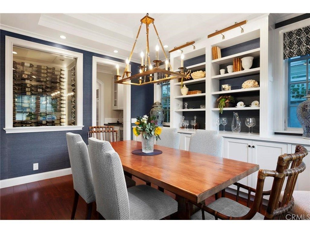 Formal Blue And White Dining With And Attached Wine Storage Room