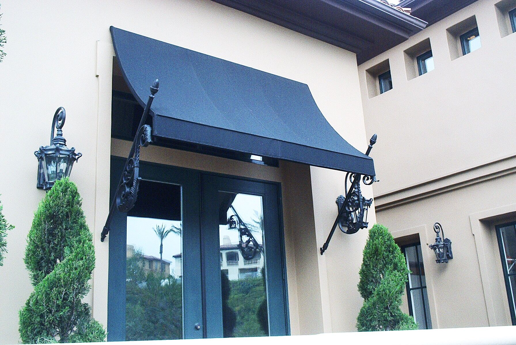 Awnings Like This Concave Fixed Awning Are A Great Way To Decoratively Extend The Shade Outside Of Your Doors And Window Window Awnings House Exterior Awning
