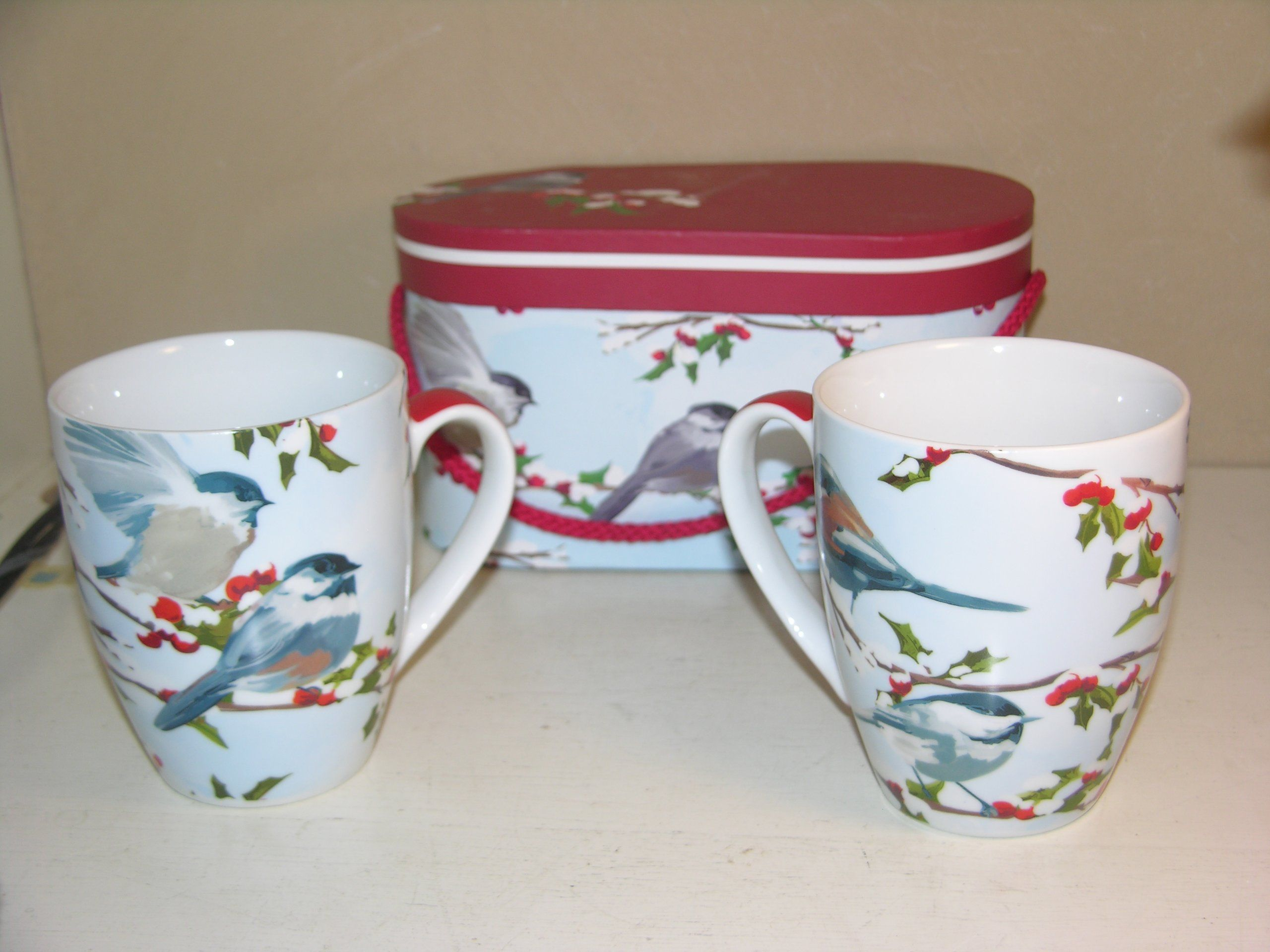 Winter Chickadee Holiday Boxed Gift Set of Two Porcelain Mugs.  Brighten your morning table with these lovely Chickadee mugs or make someone else smile when given as a Christmas gift.