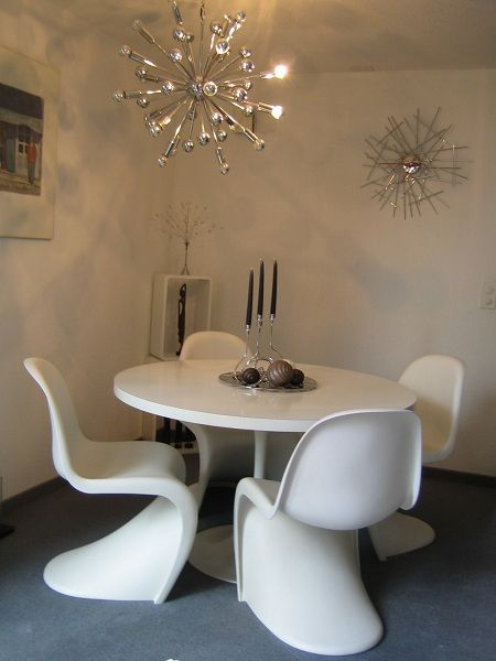White Panton Chairs And Tulip Table