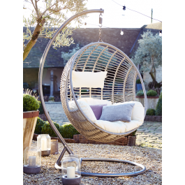 Made from durable materials that look just like light rattan, our impressive hanging chair has been intricately woven around a strong metal frame in a smooth egg shape. Big enough to snuggle up with a book and glass of wine, our stylish chair includes a sumptuously filled cream armchair seat cushion and headrest that are easily removable for storage and washing.