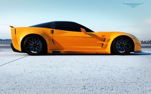 """2012 Orange GT6X by Supervettes LLC side view shot.    This Body Kit is 5"""" wider than a ZR1."""