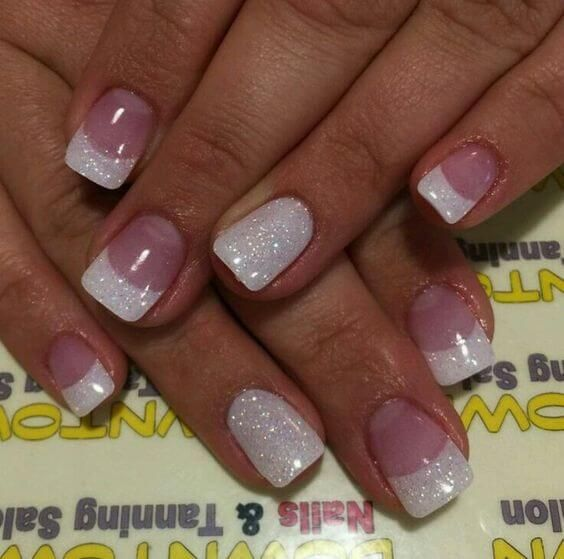 Pink gel manicure with glittery white tips and accent nail - 35 Splendid French Manicure Designs: Classic Nail Art Jazzed Up