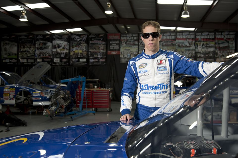 Brad Keselowski in the garage wearing Wrath.