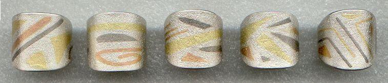 5 anéis - 2001 -  Elizabeth Franco - Ag 950, Au 750 amarelo; vermelho; branco