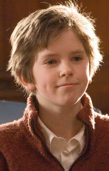 Freddie Highmore as August in August Rush