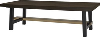 A wood plank table top alongside a polished bronze stretcher conveys relaxed glamour.