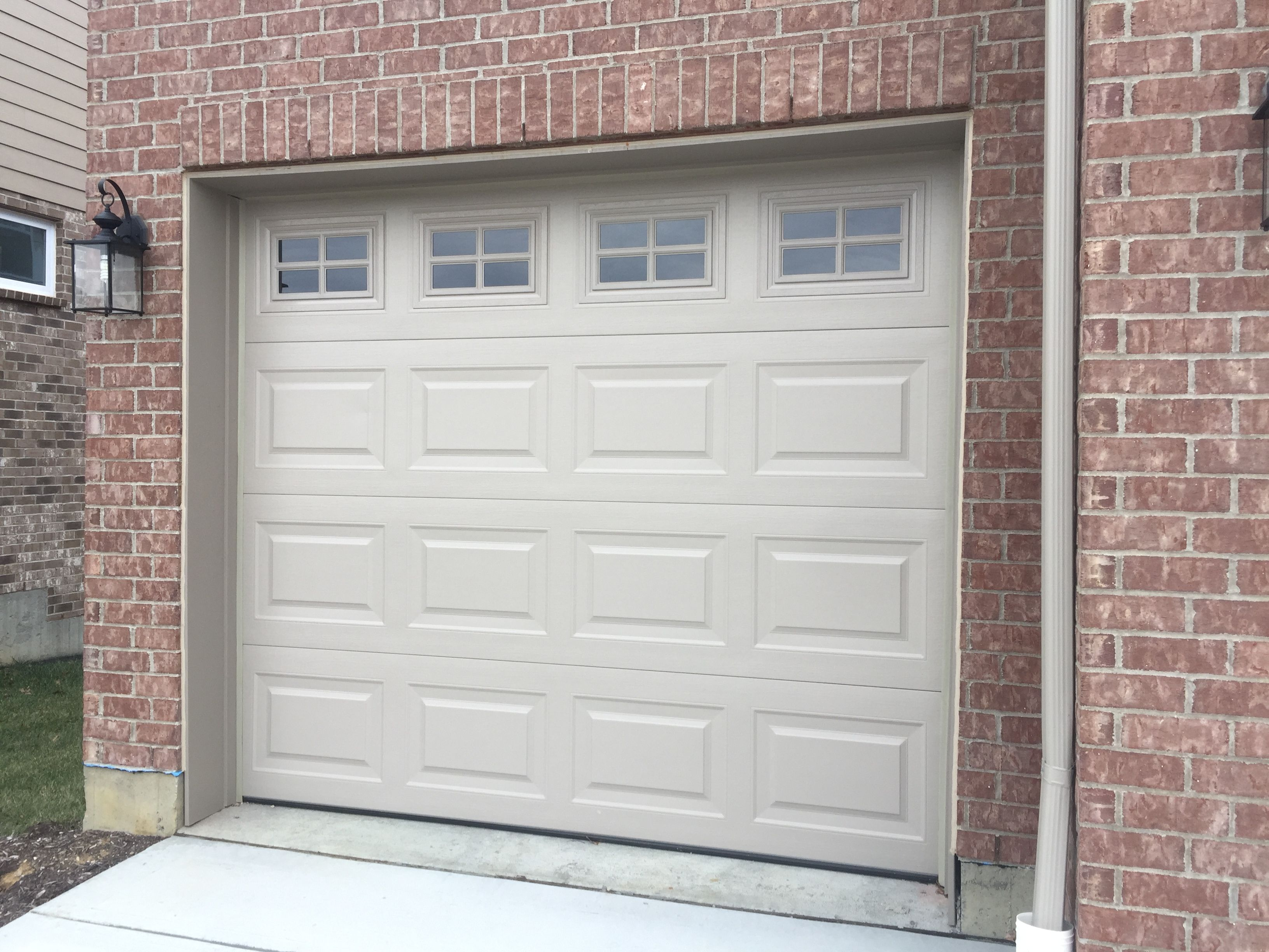 Sandstone Garage Door With Windows Garage Doors Garage Door Windows Front Door Makeover