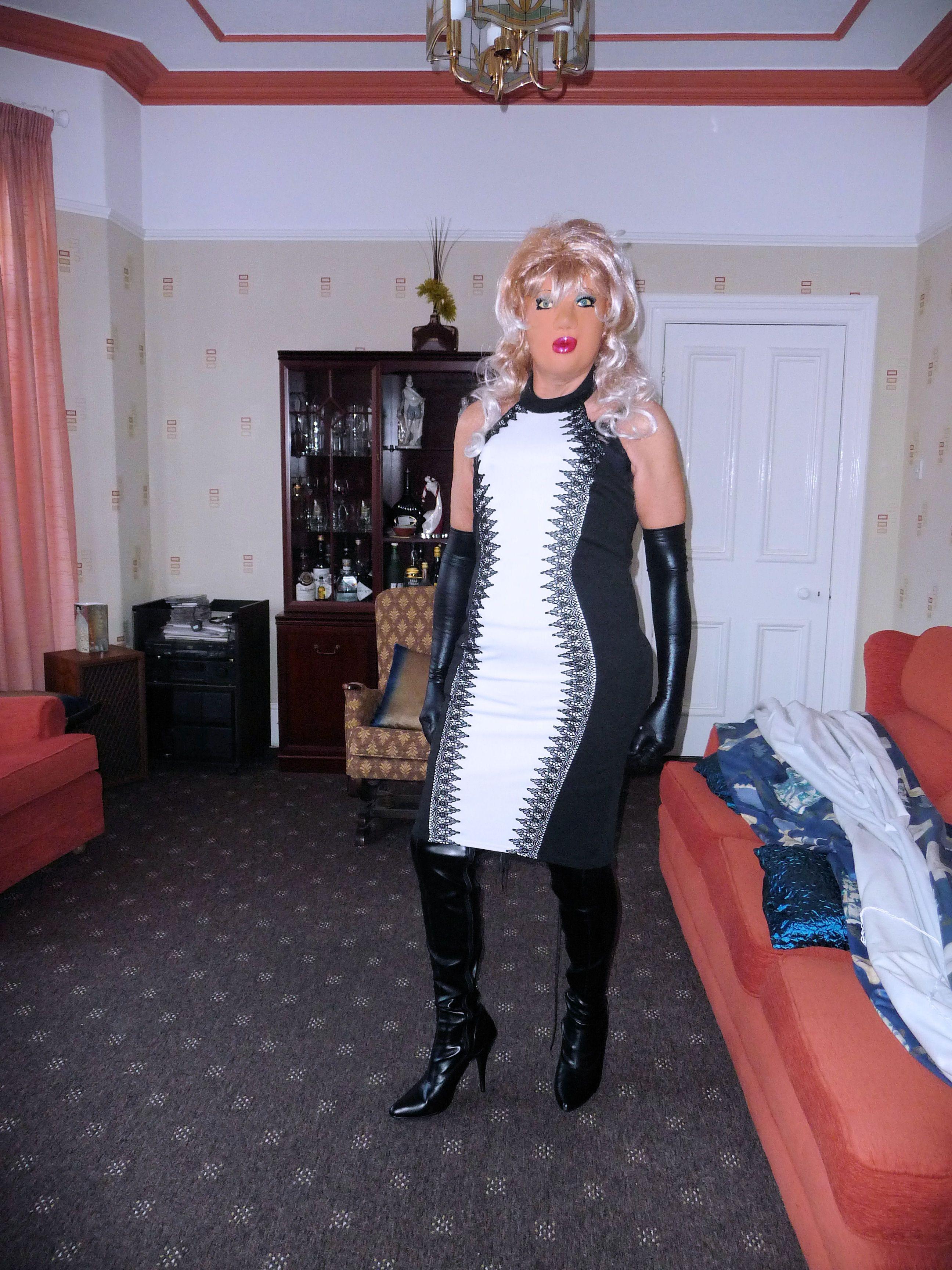 Transvestite wearing thigh boots