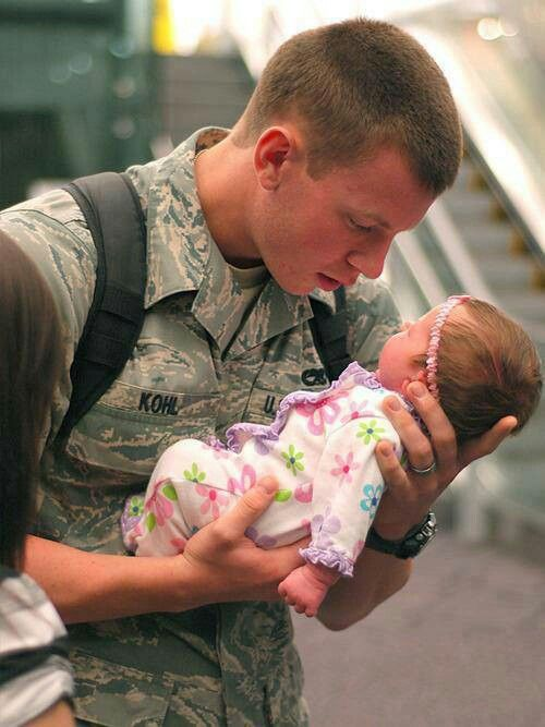 First time this soldier layed eyes on his newborn daughter... he's looking at her like she's made of gold.