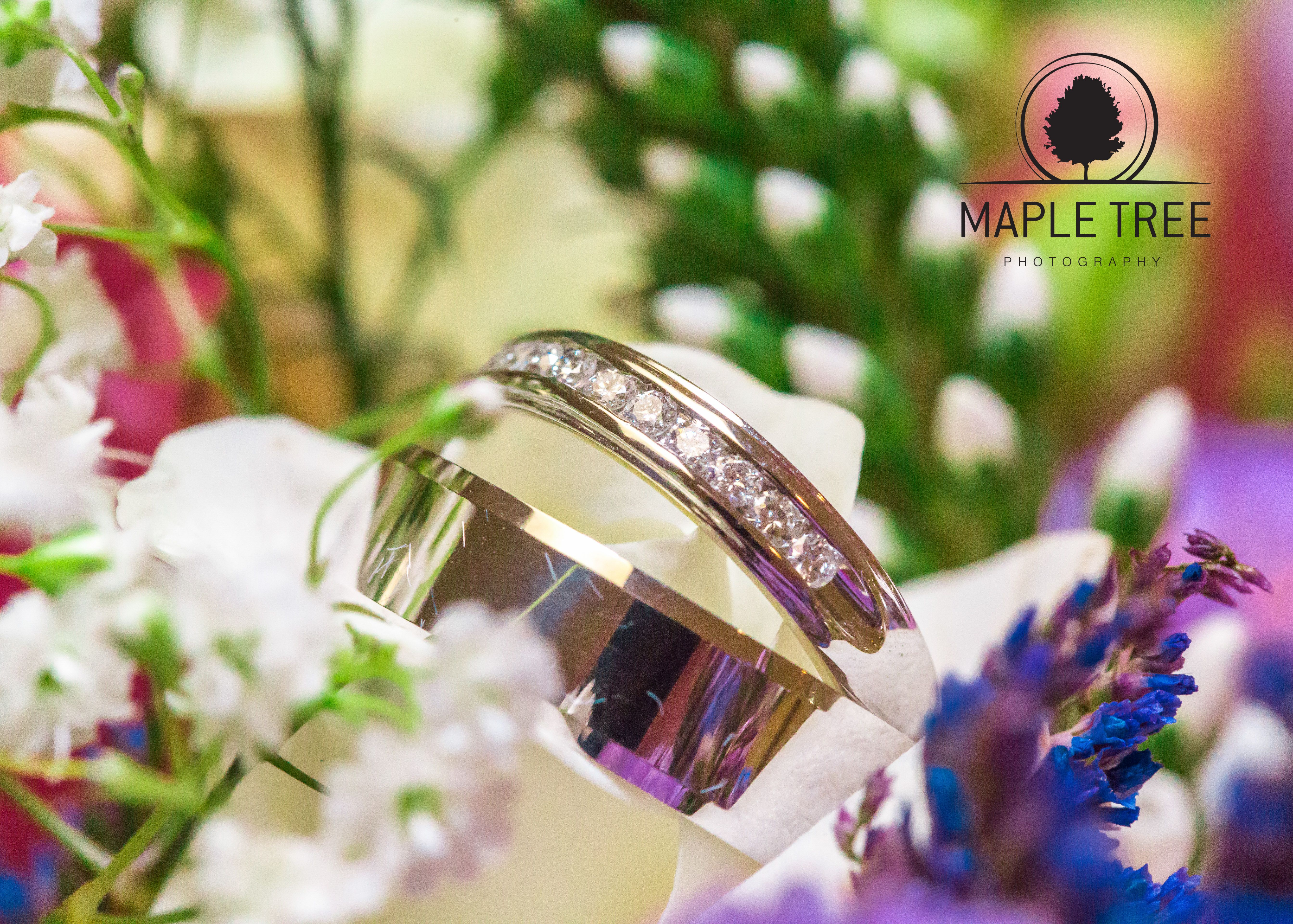 Bride and Groom's wedding rings in the bouquet.