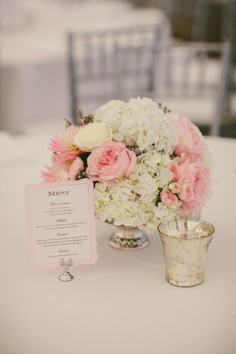 Pale pink garden roses and white hydrangea silver compote
