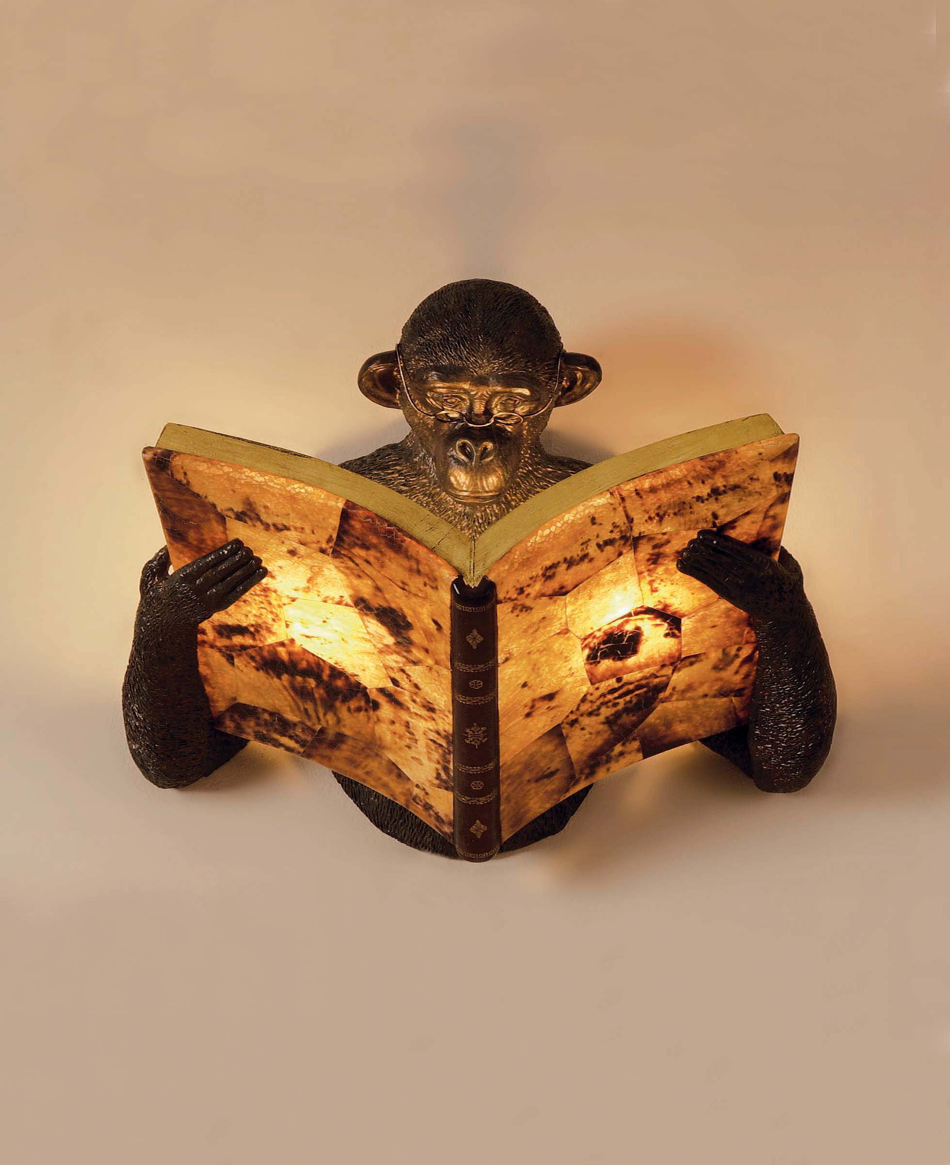 this monkey reading a book sconce is a great expression of