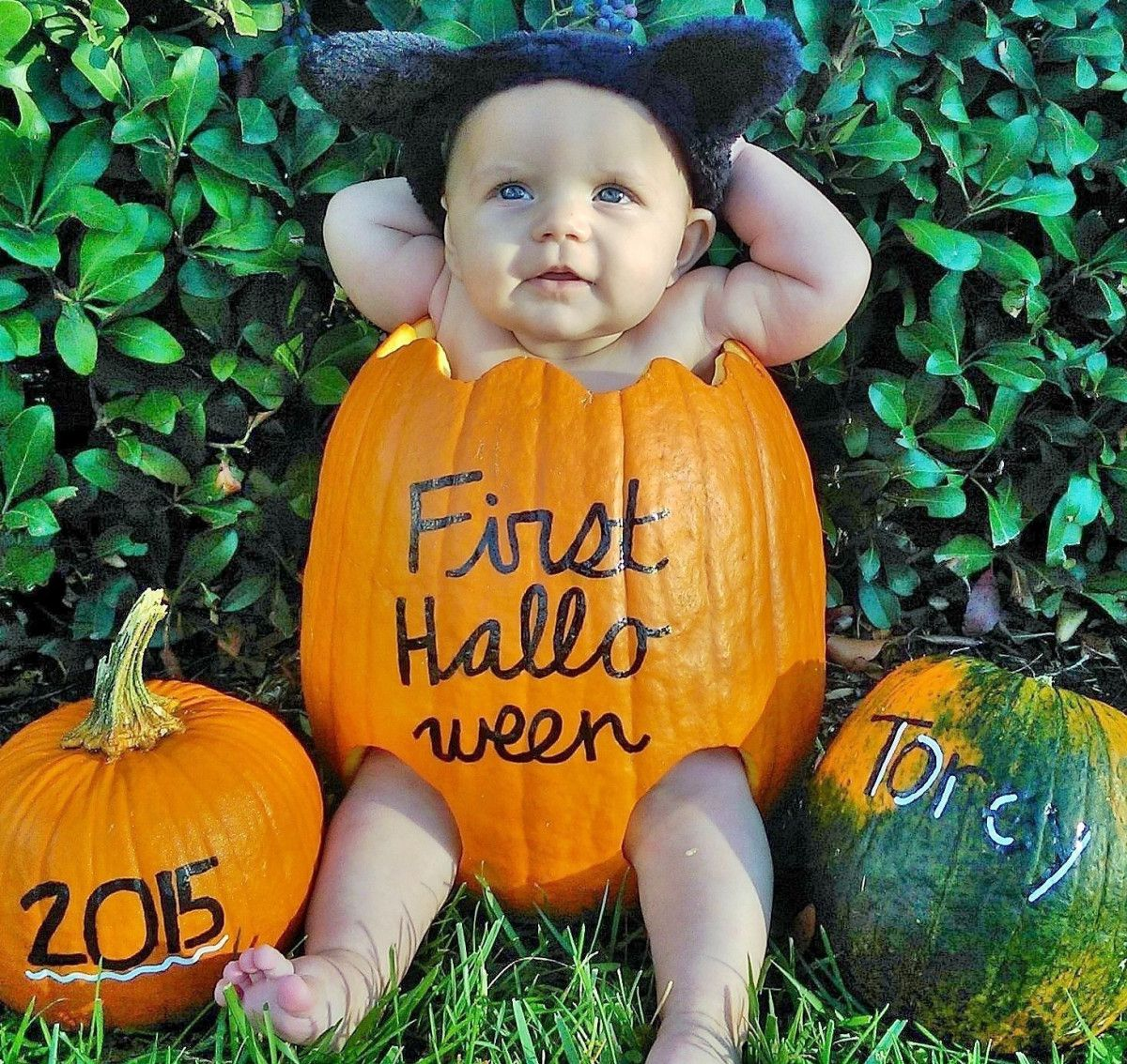 Cute DIY baby in a pumpkin for baby's first Halloween!
