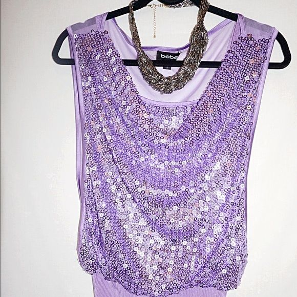 Bebe blouse Never worn Bebe blouse.  There no tag, in perfect condition.  The blouse drape down up front. Inside the blouse comes with a tank top. The necklace is not included. bebe Tops Blouses