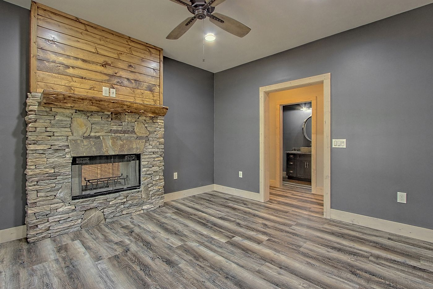 Home Office That Features A Stacked Stone Fireplace With A Raw Timber Mantel And Tongue And Groove Upper Culture Custom Homes Craftsman House Building A House