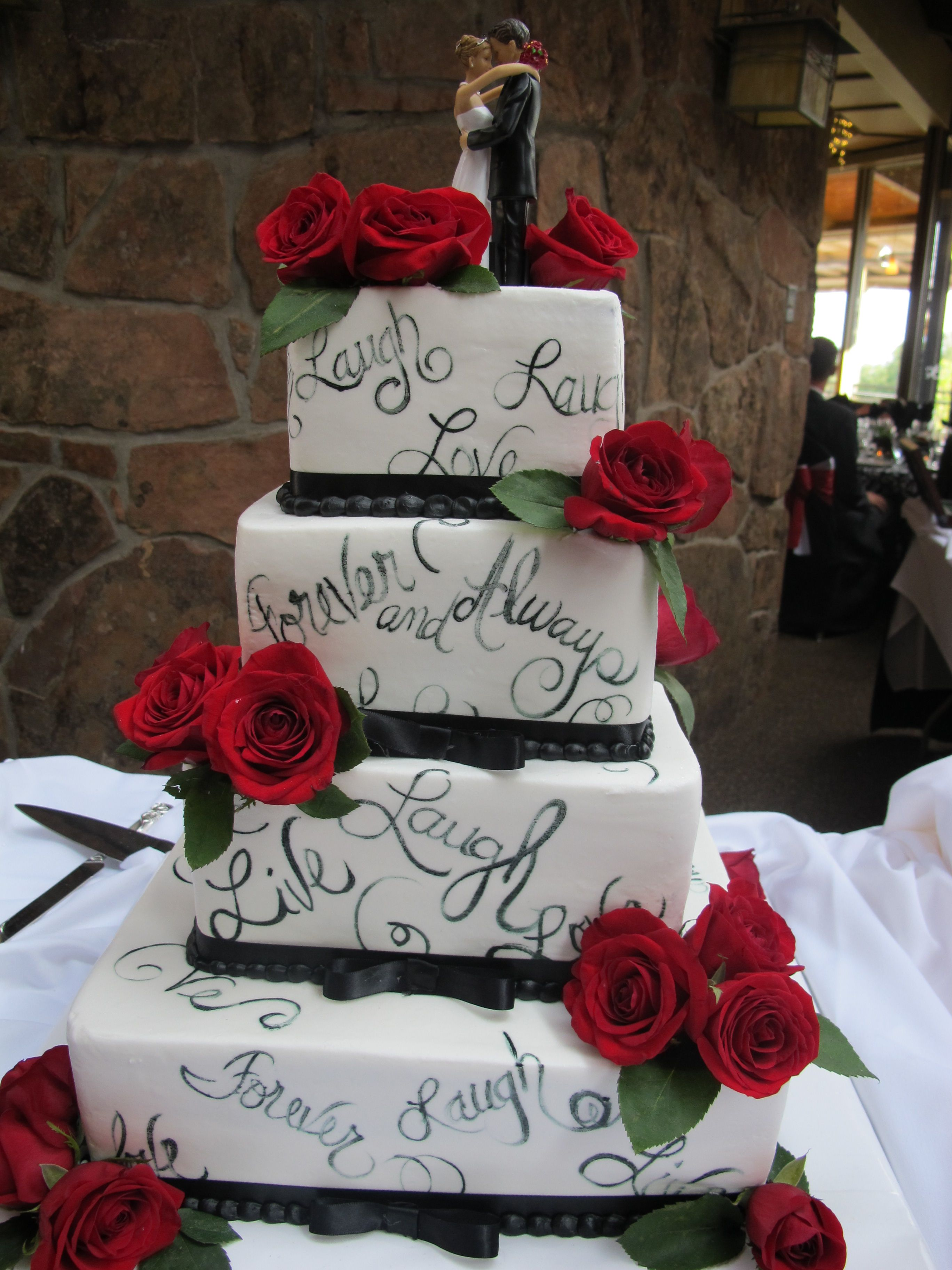 Gorgeous and creative wedding cake purple flowers and steel gray