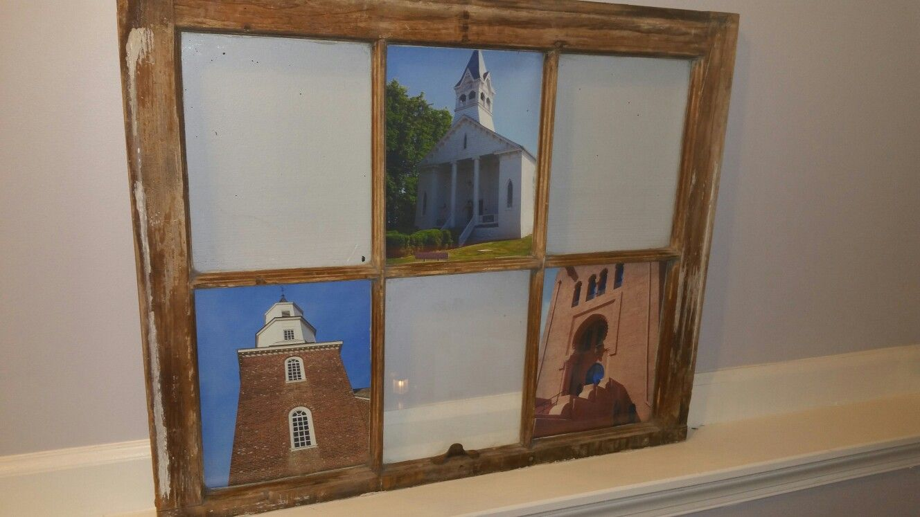 Old windowframe with pictures from travels