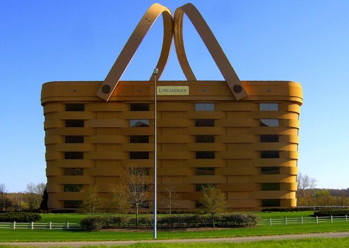 Real. The Longaberger Basket corporate headquarters in Ohio, USA. Inside the building there is an atrium that soars up to a glass ceiling, through which you can see the basket handles that come together over the roof.