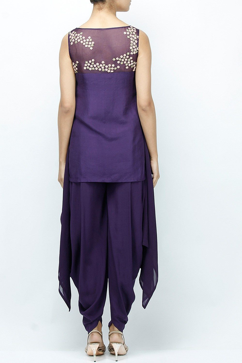 b802700c5ba Featuring a purple cut sleeved handkerchief hem kurta based in crepe with  embroidered yoke based in organza. It comes with a pair of dhoti pants in  crepe.