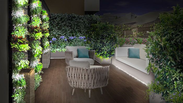 Il progetto del terrazzo area relax poltrone muri verdi