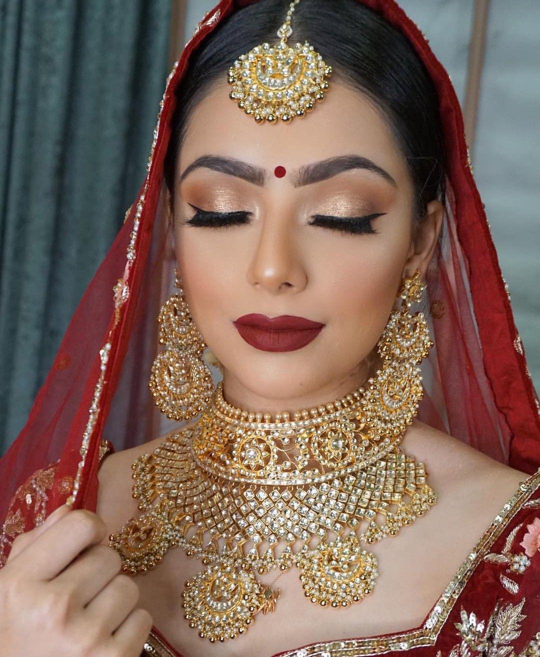 indian bridal makeup and jewellery. red bridal lehenga and