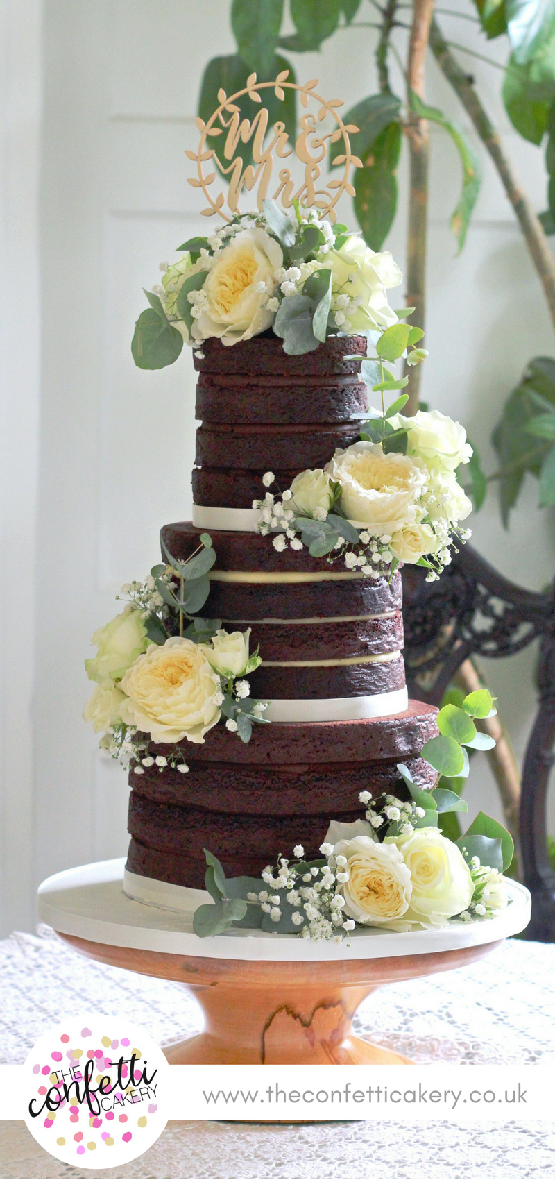 Naked chocolate wedding cake decorated with roses eucalyptus and naked chocolate wedding cake decorated with roses eucalyptus and gypsophila venue east junglespirit Images