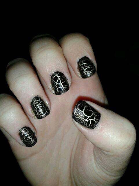 Gold with black croc effect nail art