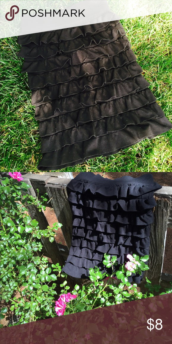 Darling Stretchy Ruffel Skirt Love this skirt! If you are a small or x small this black beauty is for you! VERY well fitting! made well IN THE USA -by 'twenty one'. Twentyone Skirts