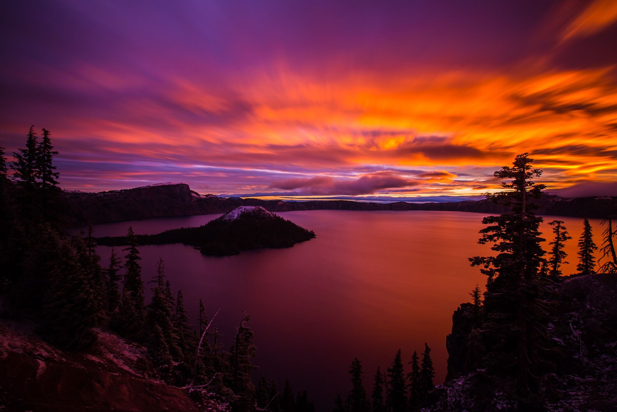 Sunrise over Crater Lake and Wizard Island in Oregon. -