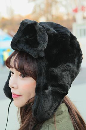 Stylenanda Mink Ear Flap Aviator HatChic mink aviator hat for the adventurous girl who dares. This accessory has warm ear flaps plus an easy self tie closure underneath. Best paired with casual outfits.
