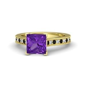 A gorgeous, 7 mm princess-cut center stone is flanked by accent gems set into the band. Tastefully stunning. $1005 by naomial