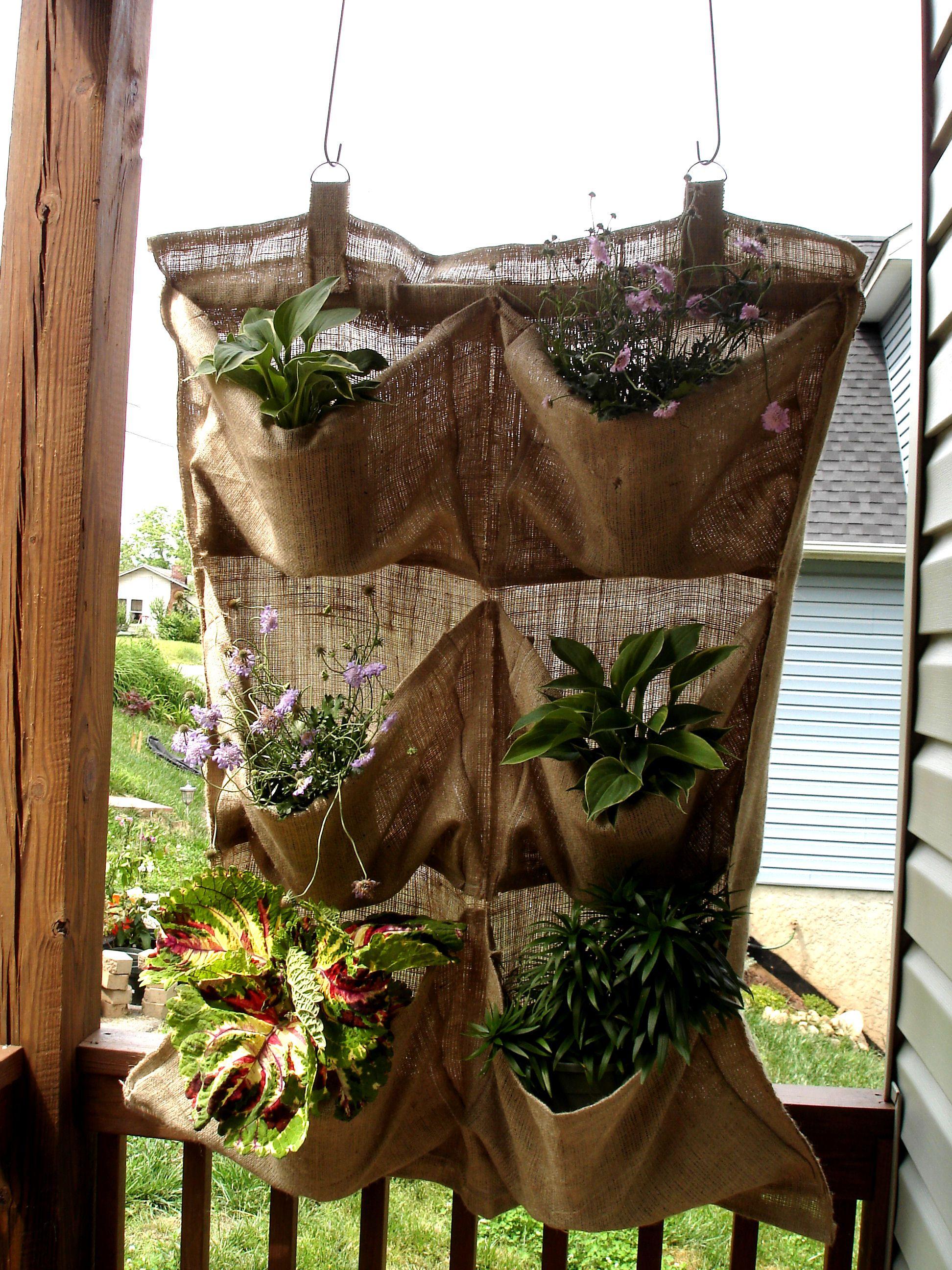 Hanging burlap planter....I wonder if I could keep plants