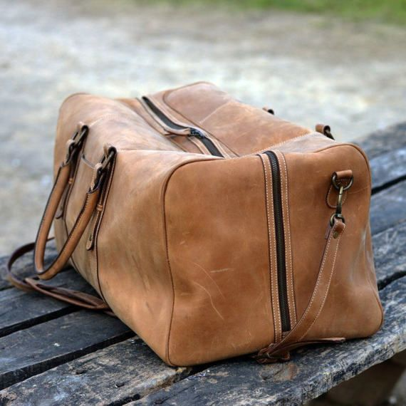 cb9c5068fb13 The Bon Voyage Leather Duffel Bag is an ideal weekender bag. Designed using  top grain cowhide leather with antique finish. The vintage carry on has a  YKK #5 ...