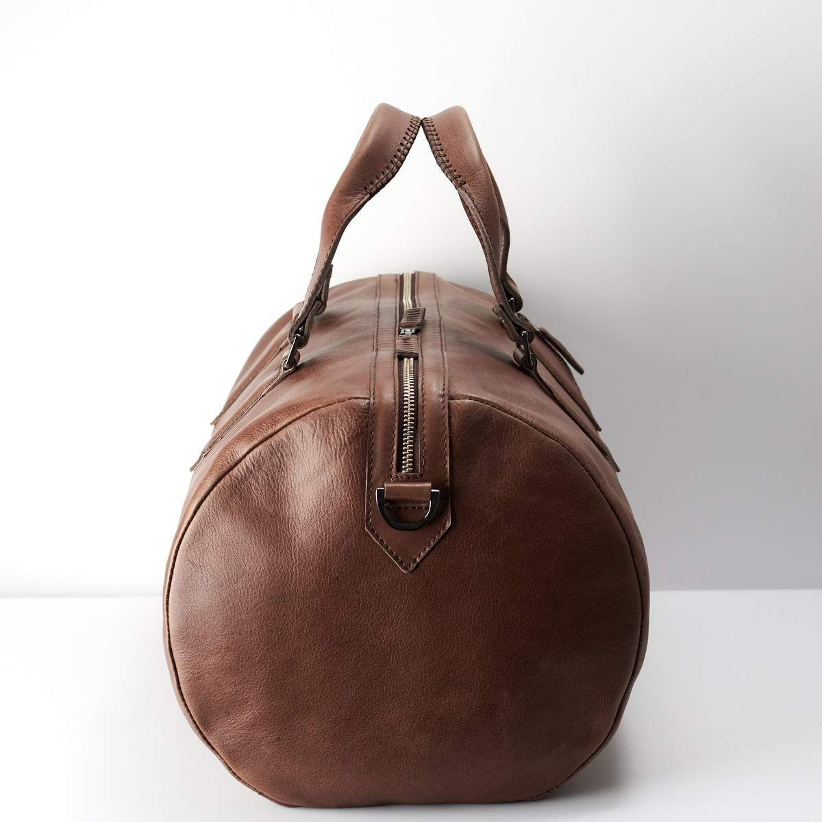 Angle. Brown Duffle Bag, Air Line Carry-on Size. Cabin