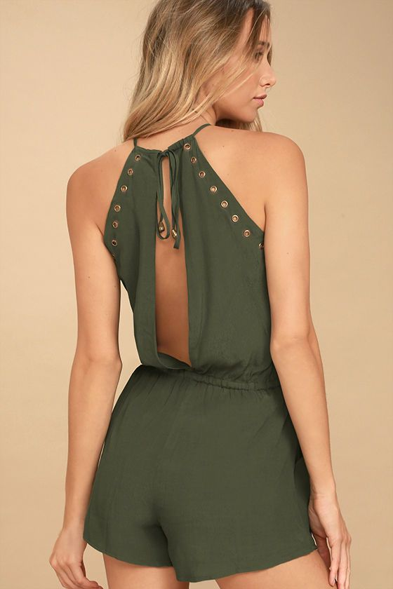 807d8566486 The Believer Olive Green Romper has us believing in fashion magic!  Lightweight woven fabric adorned in trendy brass grommets shapes a tying  apron neckline ...