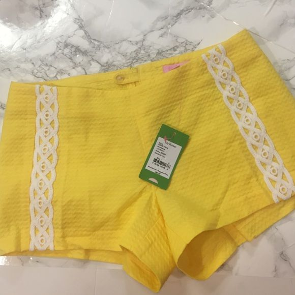 """NWT Lilly Pulitzer shorts NWT Lilly Pulitzer """"Liza"""" shorts in size 4. Bright yellow never worn. Bought but they just aren't my style so selling :) Lilly Pulitzer Shorts"""