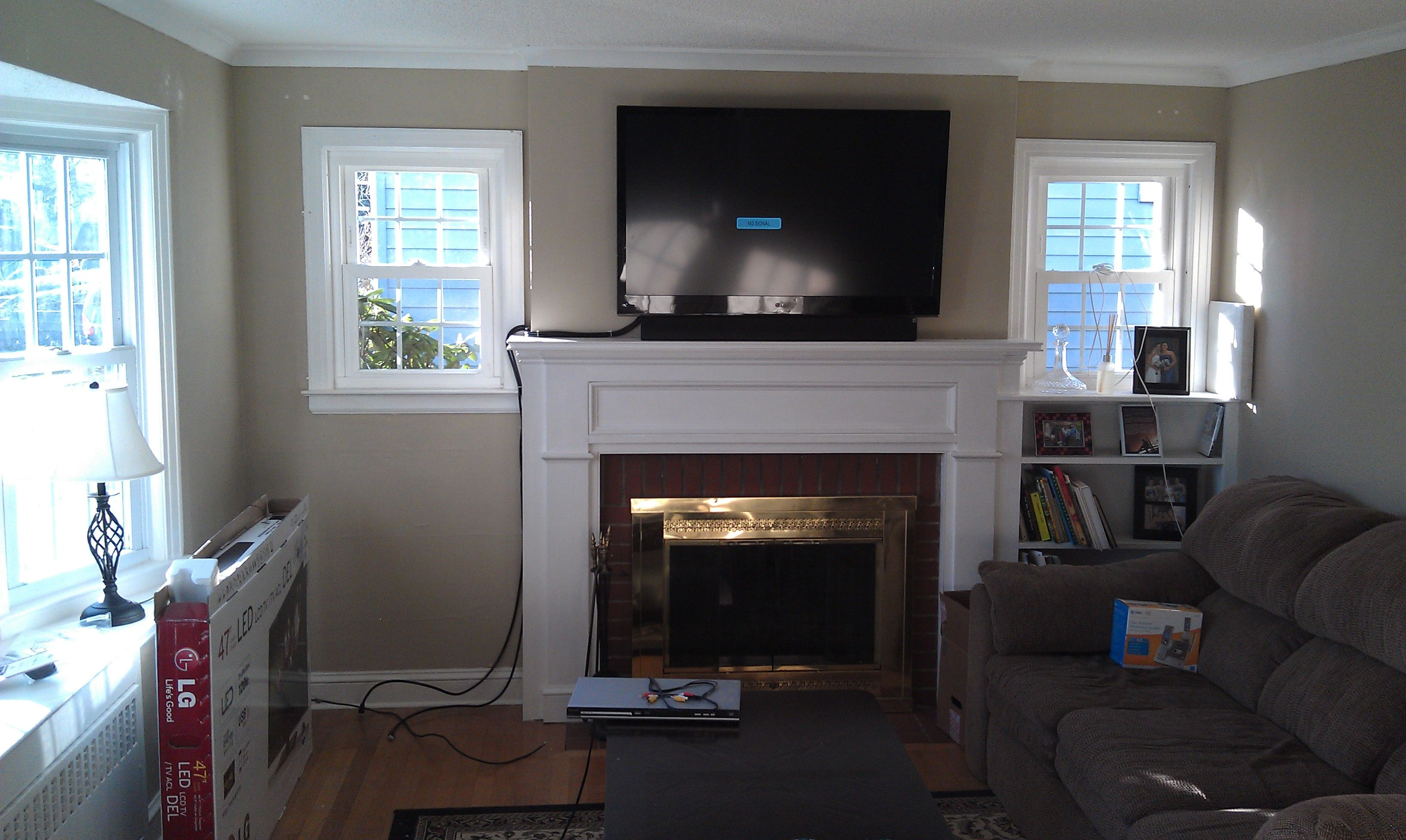 Weathersfield Ct Tv Mounted Above Fireplace With Soundbar And