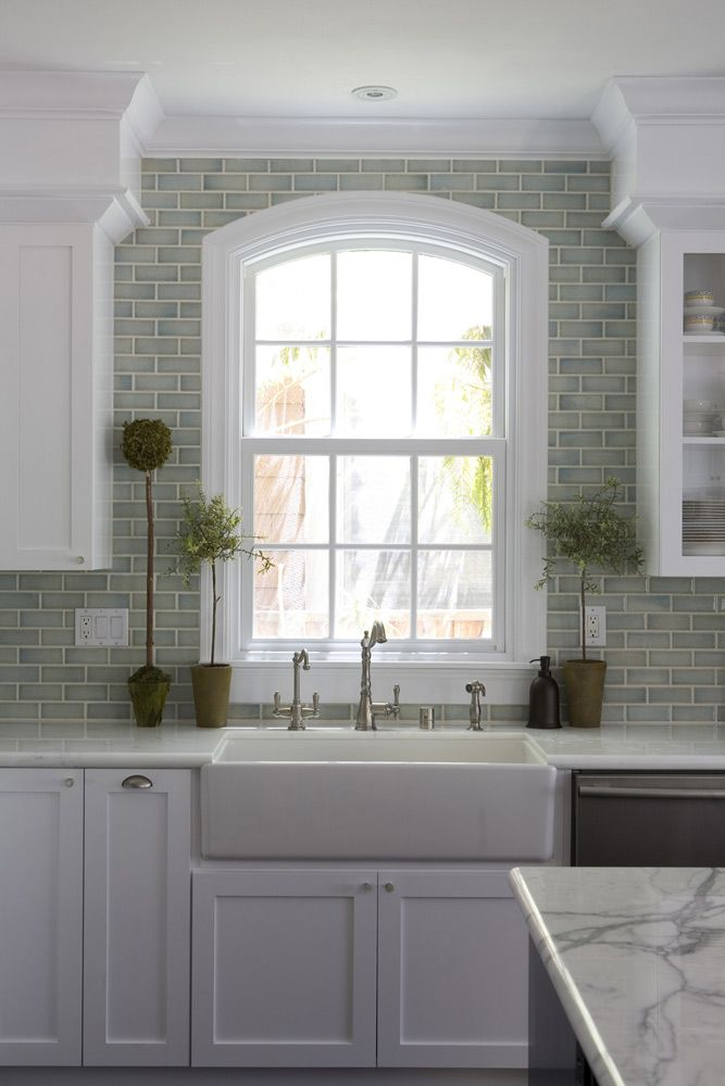 Marble backsplashlooks good in white kitchen--Fiorella Design